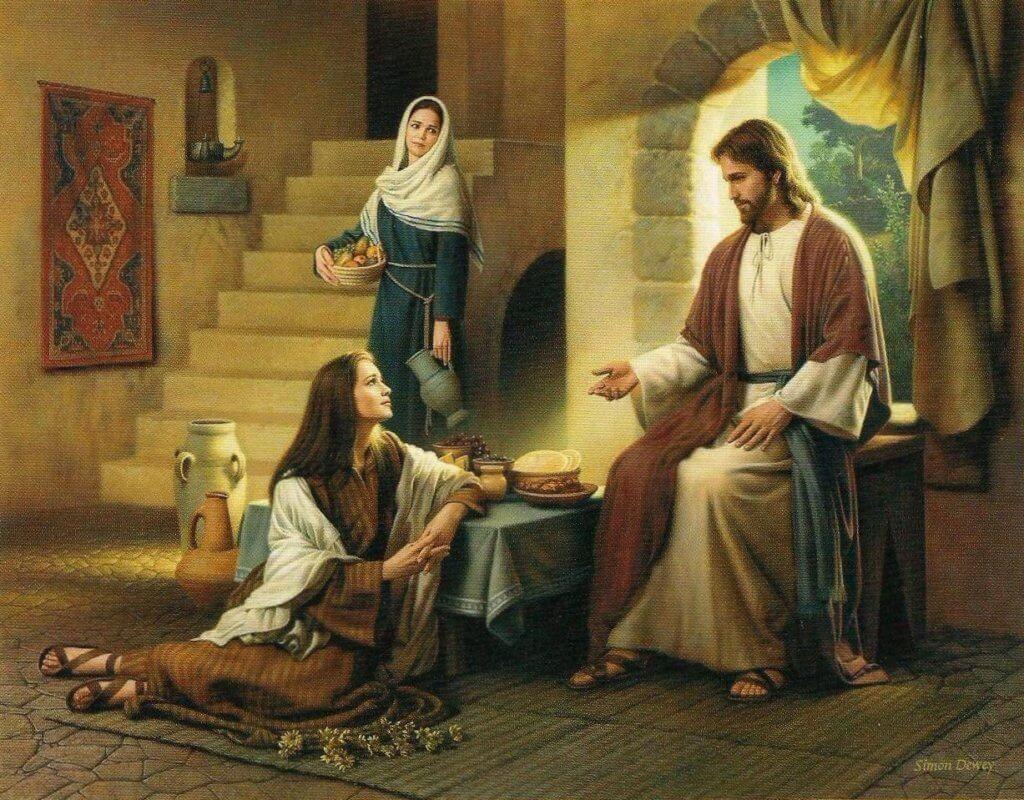 Cenário de uma casa da época bíblica.  Jesus sentado em um banco próximo à janela e uma mulher aos seus pés ouvindo-o atentamente. No fundo, outra mulher em pé ocupada, segurando objetos de casa.