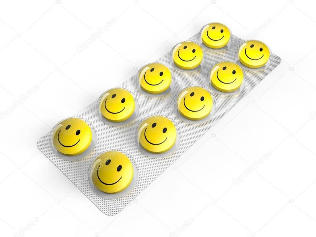 capsulas de remédio de emoji feliz