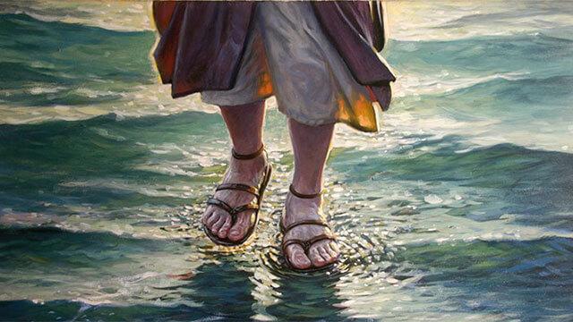 Desenho de dois pés andando sobre as águas.