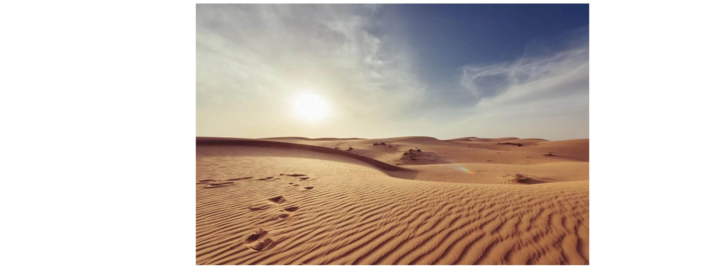 Imagem de um deserto em um da de Sol.